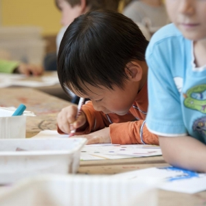 Young boy drawing at pre-school